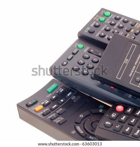 Remote controls isolated on white - stock photo