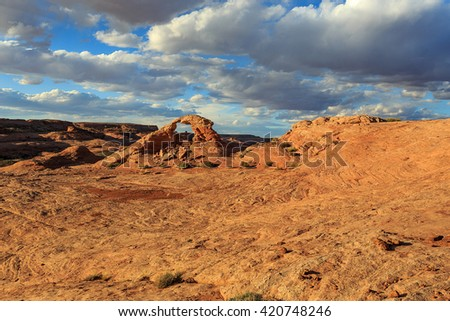 Remote desert landscape with a natural arch, Utah, USA. - stock photo