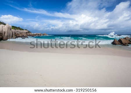 Remote Empty Beach On The Island Of La Digue In The Seychelles - stock photo