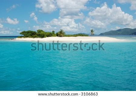Remote island with pristine white sand surrounded by turquoise waters. Sandy Spit. Jost Van Dyke.  British Virgin Islands.