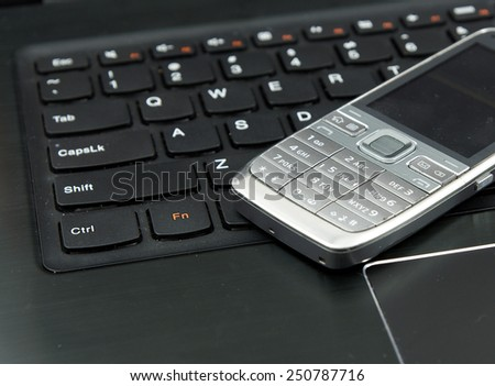 Remote work set: Laptop (notebook) and cell (mobile) phone - stock photo