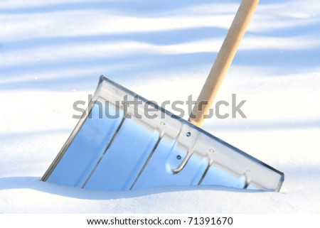 Removing snow from a driveway - stock photo