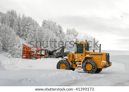 Removing snow from the road in winter - stock photo