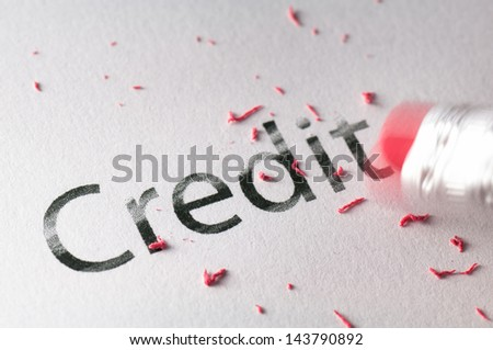 Removing word with pencil's eraser, Erasing Credit - stock photo