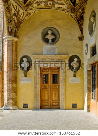 Renaissance door in the gallery of Palazzo Piccolomini e delle Papesse yard. Siena, Italy - stock photo