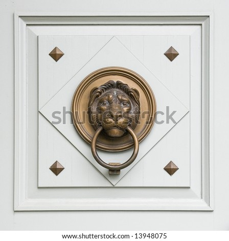 renaissance lionhead knocker from a door of a hungarian palace - stock photo