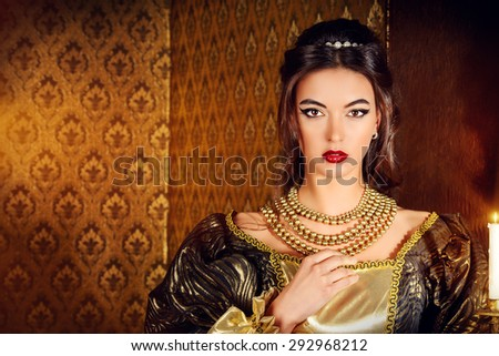 Renaissance Style -  beautiful young woman in the lush expensive dress in an old palace interior. Vintage style. Fashion. - stock photo