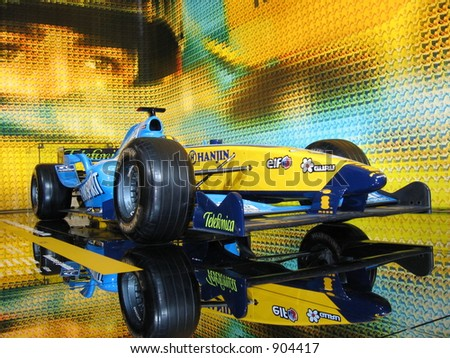 Renault F1 Formula one Fernando Alonso in car showroom - stock photo