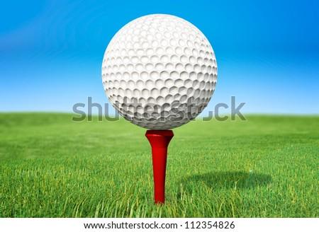 Rendered golf ball on green grass - stock photo