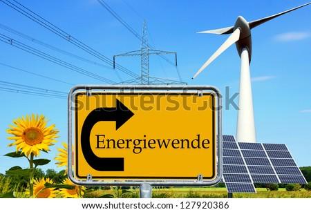 renewable energies and sign with the german words energy change / energy change - stock photo