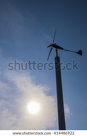 Renewable Energy concept. silhouette of wind turbine renewable energy against blue sky at dusk background