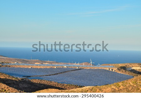 Renewable Energy Concept Solar Panels Field at Sunset - stock photo