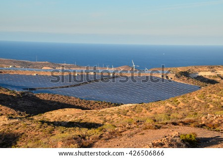 Renewable Energy Concept Solar Panels Field at Sunset - stock photo