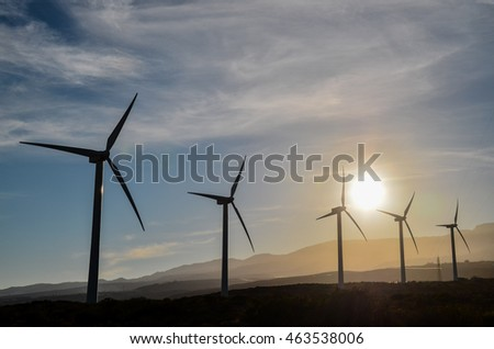 Renewable Energy Concept Windmil Farm at Sunset