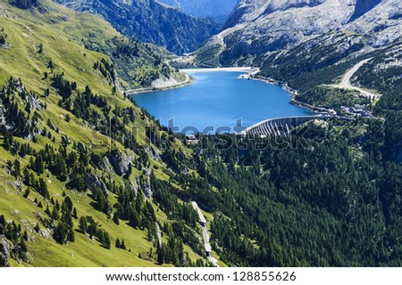 renewable energy, dam and mountain lake - Italy