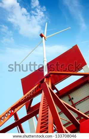 Renewable energy from solar energy panel and wind power plant - stock photo