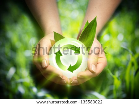 renewable energy in the hands - stock photo