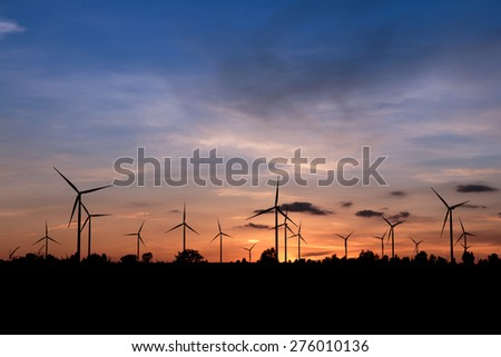 Renewable energy, Wind turbine farm silhouette at sunset in Thailand