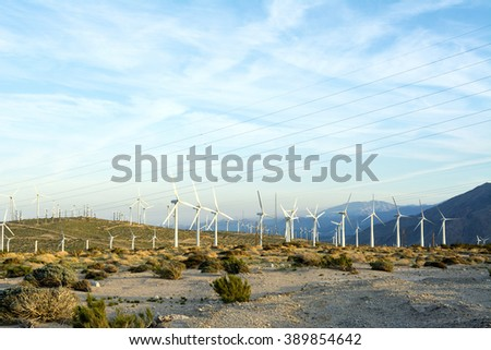 Renewable energy windmills line the mountaintops of Palm Springs - stock photo