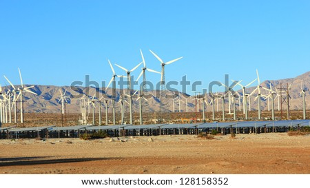 Renewable sustainable electricity from free Sun and wind energy, Palm Springs, CA - stock photo
