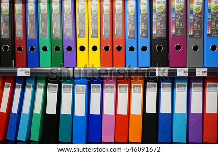 RENNES, FRANCE -28 DEC 2016- Colorful displays of binders on a shelf for sale at a Rougier et Ple stationery store in France.