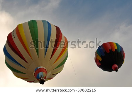 RENO, NEVADA - SEPT 12:  Two hot air balloons take flight in The Great Reno Balloon Race on Sept 12, 2009.  The race is the largest free hot air ballooning event in the Nation. - stock photo