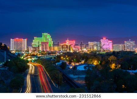 RENO - OCTOBER 31: Reno skyline on October 31, 2014. It's known as The Biggest Little City in the World, famous for its casinos and is the birthplace of the gaming corporation Harrah's Entertainment.  - stock photo