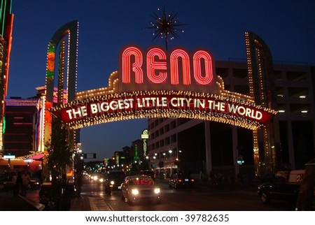 RENO - SEPTEMBER 20 : Gamblers arrive at night under the famous Virginia Street neon welcome sign September 20, 2008 in Reno. - stock photo