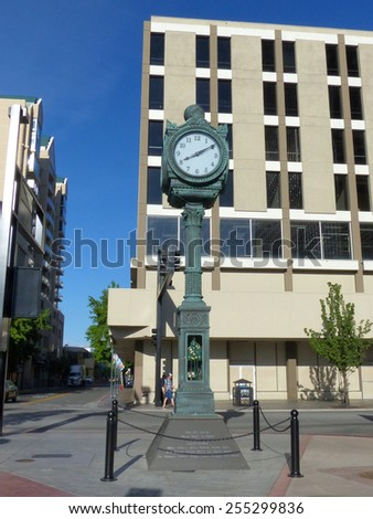 RENO, USA - AUGUST 12: Ginsbirg Clock in downtown plaza on August 12, 2014 in Reno, USA.  Reno is the most populous Nevada city outside of the Las Vegas. - stock photo