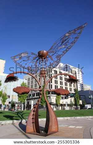 RENO, USA - AUGUST 12: Portal of Evolution sculpture in downtown plaza on August 12, 2014 in Reno, USA.  Reno is the most populous Nevada city outside of the Las Vegas - stock photo