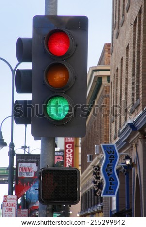 RENO, USA - AUGUST 12: Traffic light in the street on August 12, 2014 in Reno, USA.  Reno is the most populous Nevada city outside of the Las Vegas. - stock photo