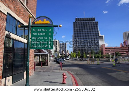 RENO, USA - AUGUST 12: Viriginia street in city center on August 12, 2014 in Reno, USA.  Reno is the most populous Nevada city outside of the Las Vegas. - stock photo