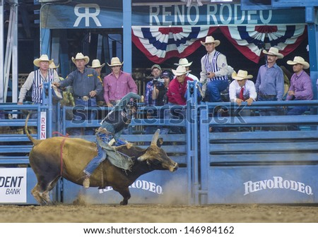 RENO , USA - JUNE 27 : Cowboy Participant in a Bull riding Competition at the Reno Rodeo  a Professional Rodeo held in Reno Nevada , USA on June 27 2013