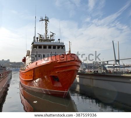 Renovated  rescue  vessel  is removed  from  the floating  dock - stock photo