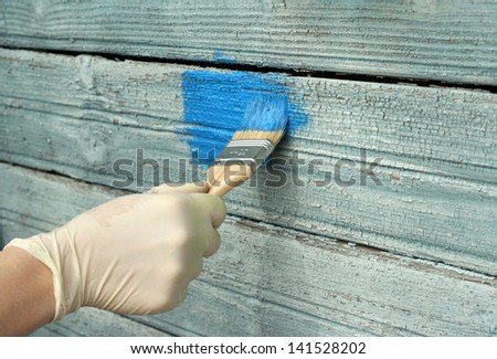 renovation old wall painting, light blue paint - stock photo