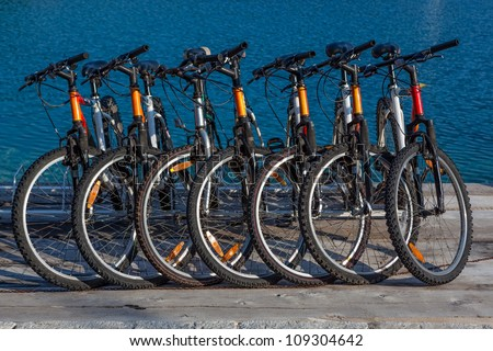 Rent-a-bike services. Bicycles ready for renting. - stock photo