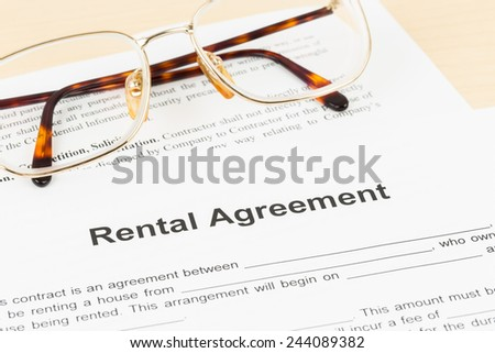 Rental agreement document with glasses - stock photo