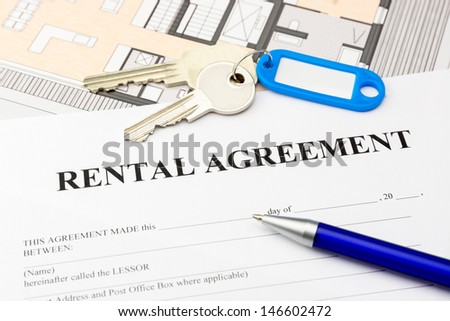 rental agreement document with keys and blue pen - stock photo
