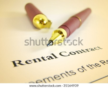 Rental contract form with pen - stock photo