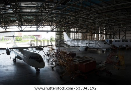 Repair and maintenance of passenger airplanes in the aviation hangar