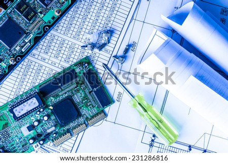 Repair broken computer, a chip with a screwdriver on the table - stock photo