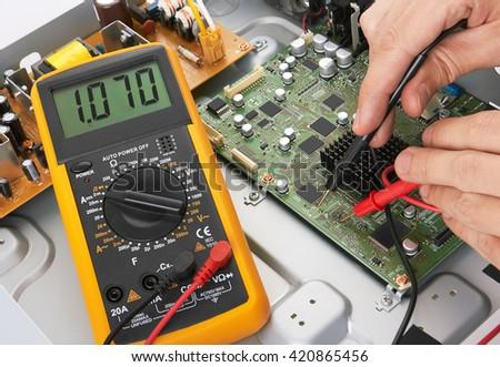Repair electronic circuit board, close-up - stock photo