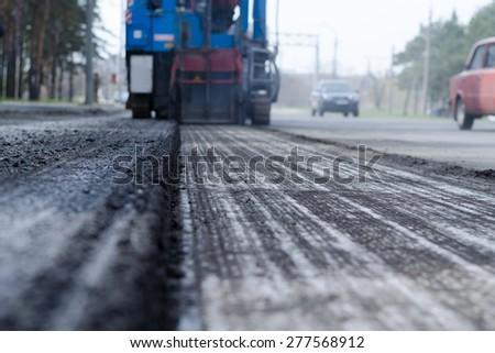 repair of asphalt - stock photo