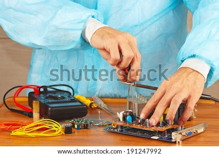 Repair of electronic components in a service workshop - stock photo