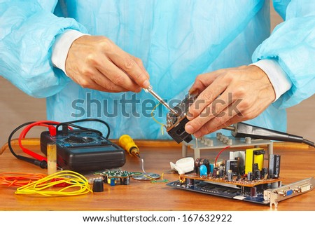Repair of electronic devices in the service workshop - stock photo