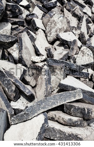 repair of road - many old used asphalt pieces close up - stock photo