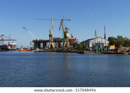 Repair of the oil rig in the shipyard - Gdansk in Poland - stock photo