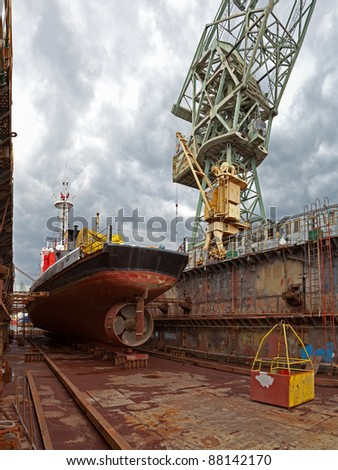 Repair of the vessel at the dock. Gdansk, Poland. - stock photo