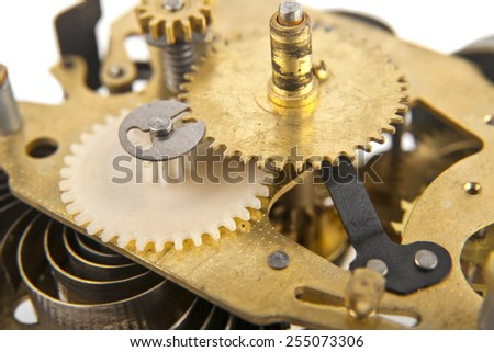 repair parts for a mechanical clock on a white background