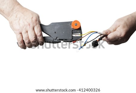 Repair, renovation, electricity and energy concept. Electrician peeling off insulation from wires isolated on white background. Copy space for text. Close up of hands with pliers.  - stock photo